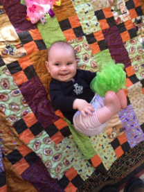 Baby Finley on a Halloween Quilt