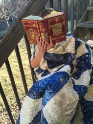 Reading to escape on a ship quilt