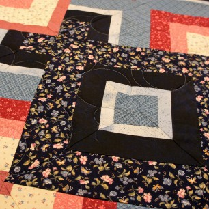 The circle meander looks great on this geometric diamond piecing.